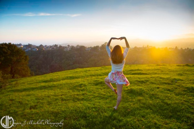 woman dancing outdoors at sunset