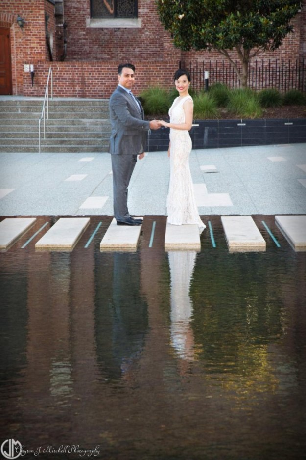 bride-and-groom-in-reflecting-pool-photograph