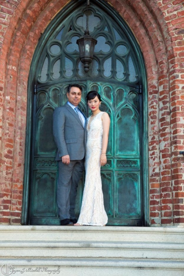 bride-and-groom-with-copper-patina-doors