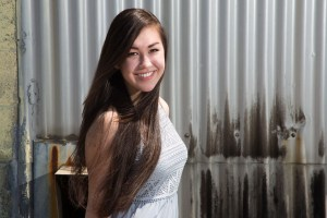 Smiling midrange girl on corrugated iron