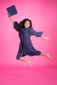 Jump shot Graduation Portrait on pink
