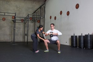Crossfit trainer teaches kettle bell