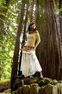 Dramatic model on stump in Redwoods