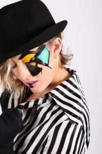 Clockwork orange style makeup on model with a hat