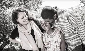 Black and white family portrait smiling