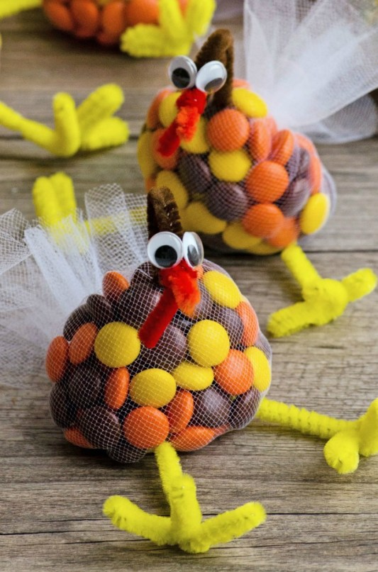 kids thanksgiving party ideas turkey treats made with M&Ms, pipe cleaners, and tulle