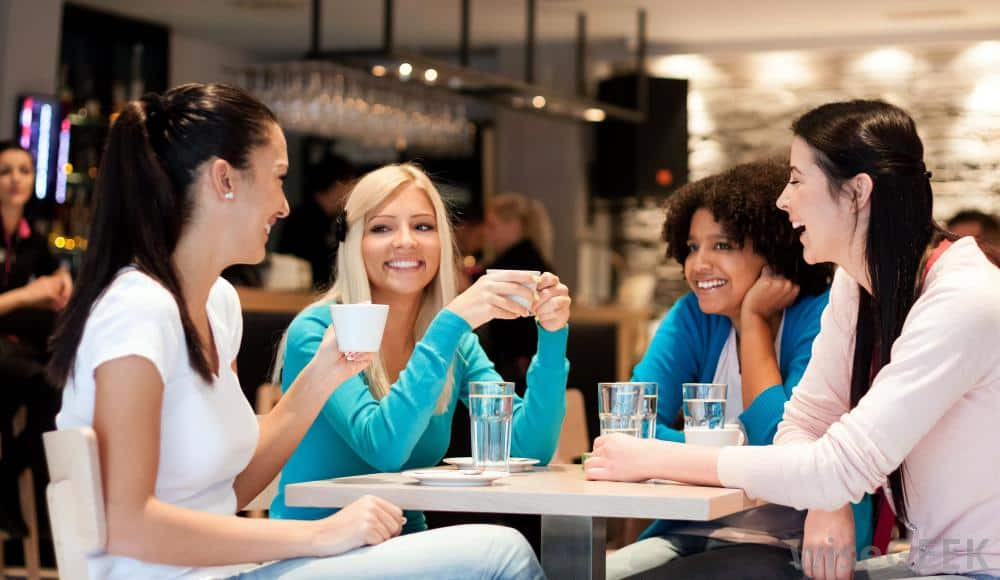 group-of-women-talking-at-table