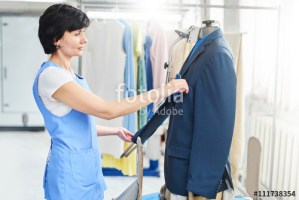 Female worker in Laundry service the process of working on unive