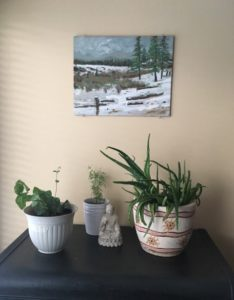 plants and picture in living room