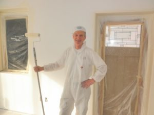 house painter posing with brush