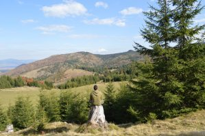 Man meditating looking into valley