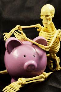 Skeleton and piggy bank