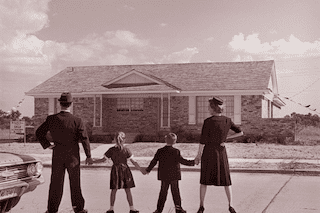 fifties family in front of house