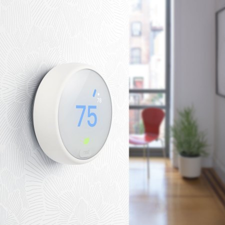 Nest Learning Thermostat on wall
