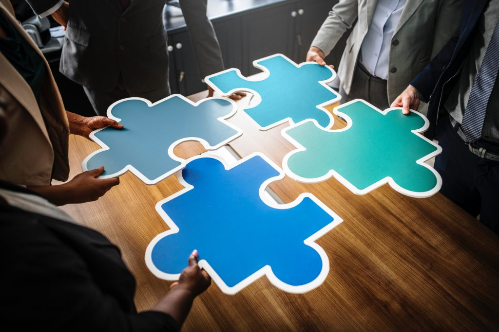 "People putting together the ""business"" puzzle"
