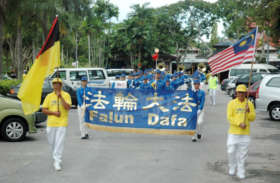 The Divine Land Marching Band performs near the seaside at Port Dickson