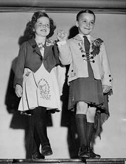 Boy and girl in Irish dance costume