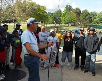 The children get a quick lesson on fishing from Captain Vytus prior to going out on the Linda Mae at Wildwood Park.