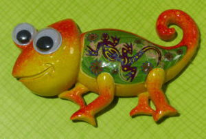 Yellow and orange chameleon magnet with wobbly eyes