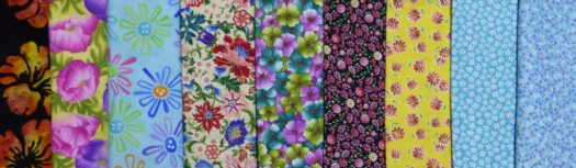 Fabrics showing a decrease in the scale of the flower print from left to right.