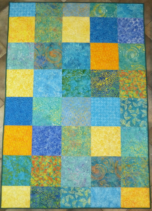 "Child's quilt backing made from 10"" squares"