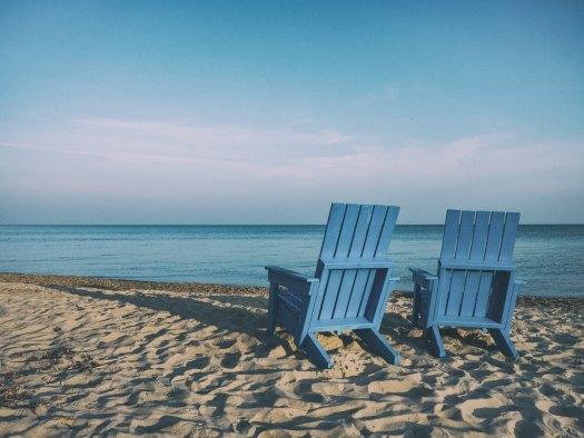 blue chairs on a beach