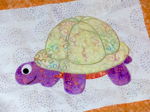Toddling Turtle appliqué from the Love with a Twist series by Dione Gardner-Stephen of Clever Chameleon
