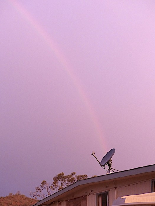Rainbow ends at a satellite dish