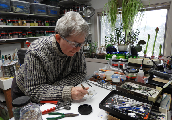 Nan Burke at work on glass landscapes