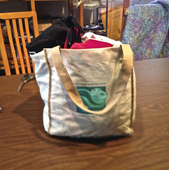 A bag of sports tee shirts Liz Foss will use for a quilt.