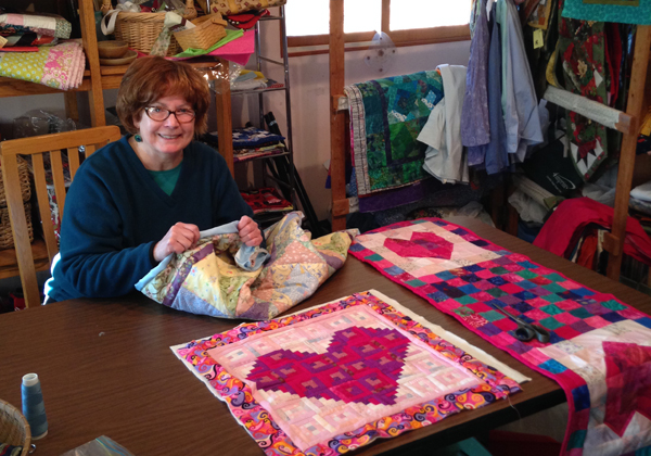 Liz Foss makes quilts, table runners, pot holders and wall hangings for the home.