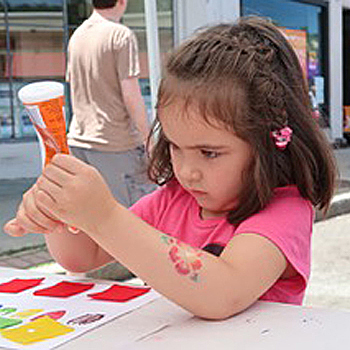 Young girl making a square for the mosaic