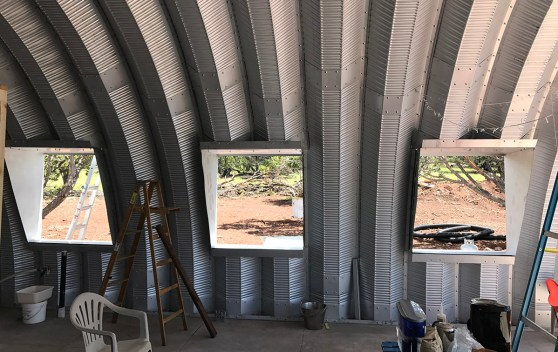 Clever Moderns Quonset hut house construction window installation