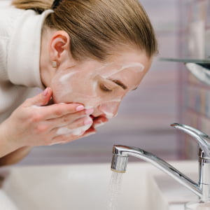 washing face with soap