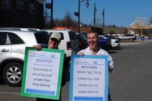 Advocates in Motion March for Inclusion volunteers with signs