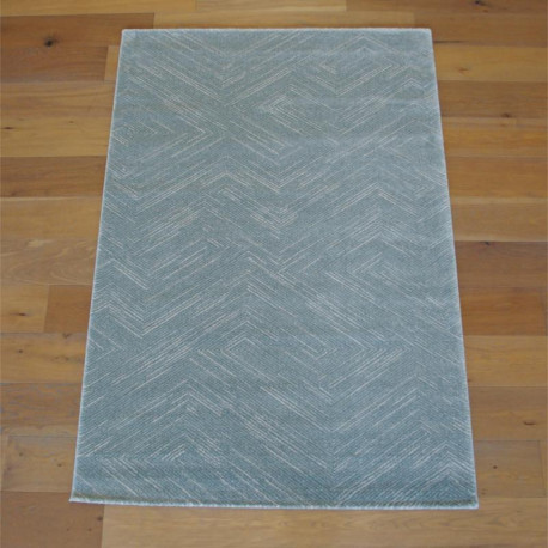 tapis bleu pastel motif geometrique fondu 140x200 opus balta