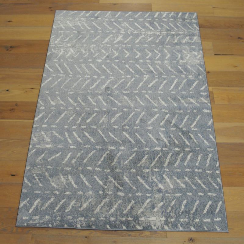 tapis tout doux fly gris fonce a motif chevrons ethniques balta 160x230cm