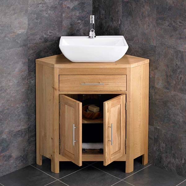 corner vanity unit with double doors and ceramic basin plus tap and waste alta