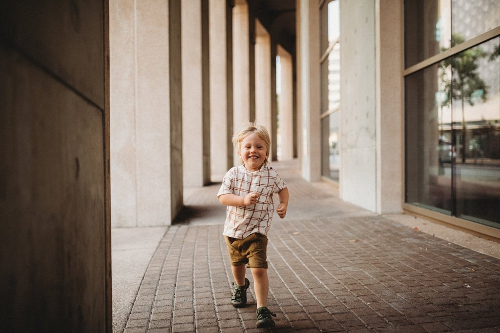 Toddler boy running outside the Vancouver Library