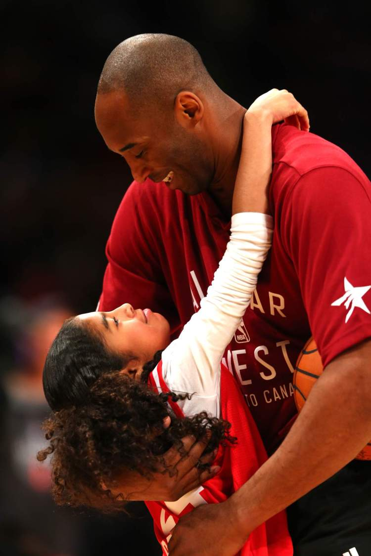 Kobe Bryant warms up with daughter Gianna Bryant during the NBA All-Star Game 2016 at the Air Canada Centre in Toronto.