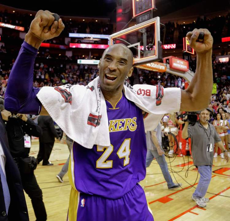 Kobe Bryant reacts to the crowd as he leaves the court April 10, 2016 in Houston.