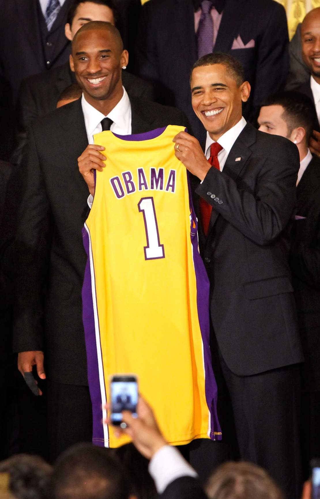 Then-President Barack Obama, at right, poses for photos with Kobe Bryant and members of the NBA 2009 champion Los Angeles Lakers -- this was taken in the East Room of the White House on Jan. 25, 2010.