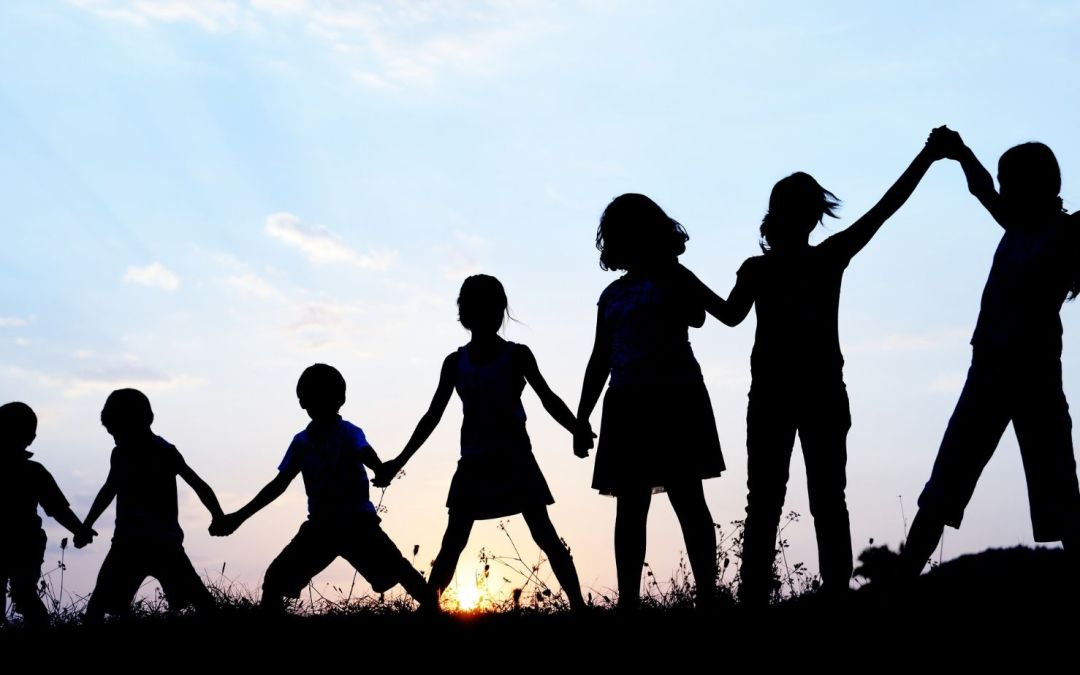 Photo of children holding hands