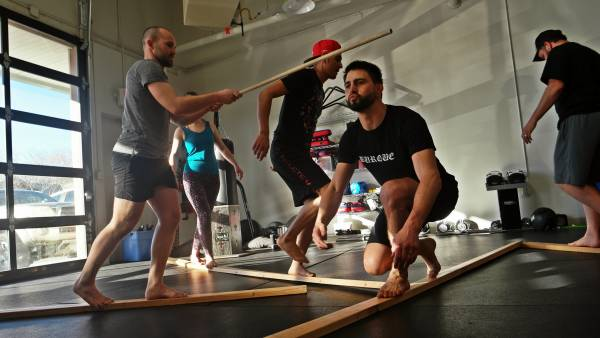 There is a group of trainers showing different movements during the workout, this shows why you should diversify your movement portfolio.