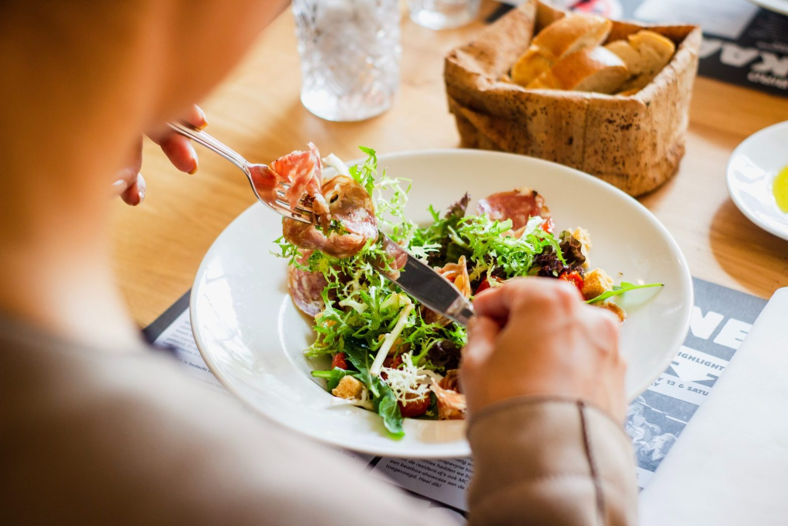 A person eating a salad. Fad diet myths.
