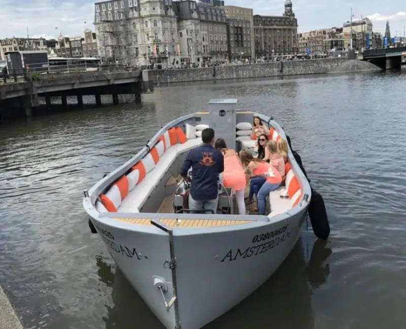 Family on boat | Clink Hostels | Family holiday in Amsterdam