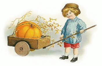 Little girl with a pumpkin in a cart