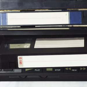 Stack of VHS tapes on VCR