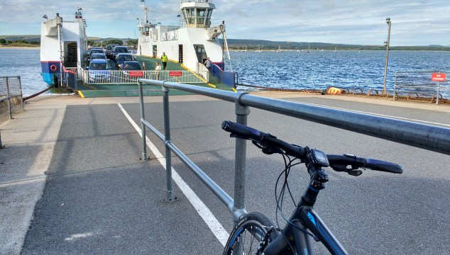 My bike on the quay with ferry approaching