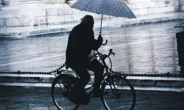 Cyclist with umbrella